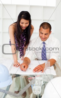Two engineers studying plans