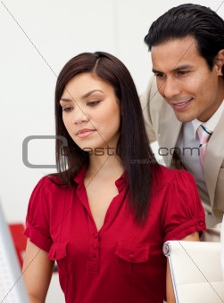 Businessman and businesswoman work with a laptop at the office