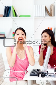 One businesswoman yelling and one businesswoman asking for silen
