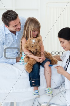 A doctor checking child's