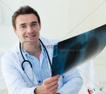 Attractive doctor examining an x-ray