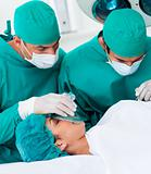 Close-up of surgeons near patient lying on operating table