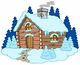 Wooden cottage in winter landscape