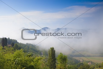 Beautiful Italian landscape with hills and low clouds