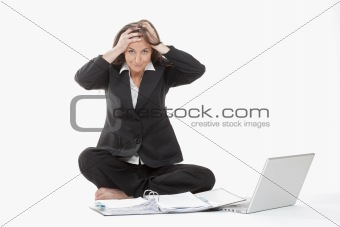 attractive young businesswoman working with laptop computer concerned
