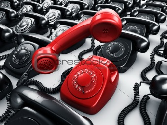 Red rotary phone surrounded by black phones