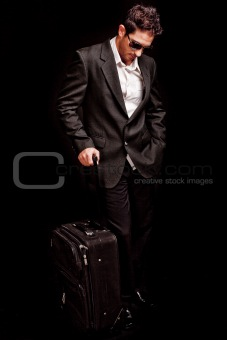 Business man looking down with his luggage