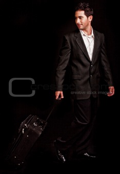 Business man pulling his luggage
