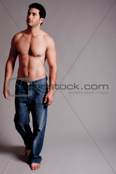 Topless Masculine man looking the right corner