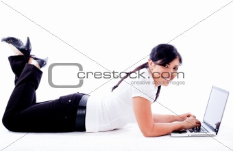 Business woman lying with laptop