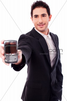 Business man showing a mobile phone