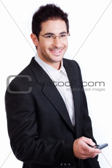 Young attractive business man holding a mobile and smile