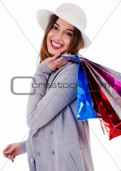 Beautiful young women holding her shopping bags