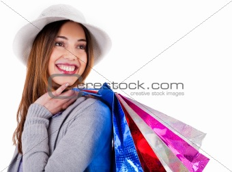 Portrait of young beautiful model carrying her shopping bags