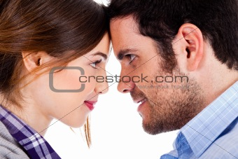 Beautiful couple smiling and facing each other