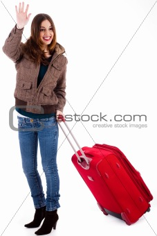 Attractive young women travelling with suitcase