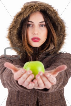 Beautiful young lady showing green apple