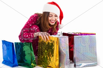 Santa girl looking into the shopping bags