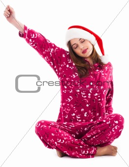 Santa girl relaxing by streching her right hand