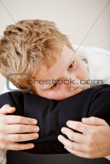 Boy resting his head on a pillow