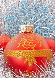 Red Christmas balls among silver glittering decoration