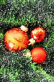 Red Christmas balls among green new year tree