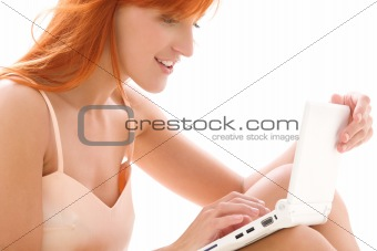 happy redhead woman with laptop computer