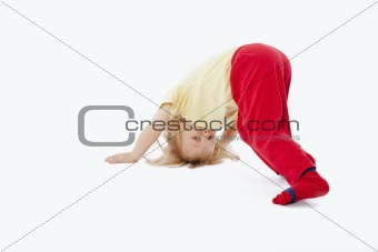 boy with long blond hair trying to stand on his head
