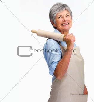 Happy woman with a rolling pin looking at copyspace over white