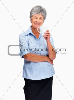 Charming elderly woman holding coffee or tea cup over white