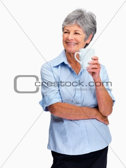 Smiling thoughtful old woman holding coffee or tea cup