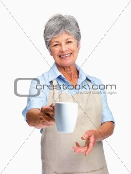 Charming old woman offering you a cup of coffee or tea