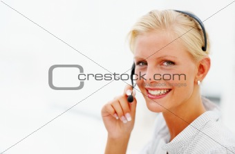 Portrait of a happy young call centre employee