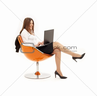 businesswoman with laptop in orange chair