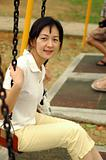 Chinese lady on swing