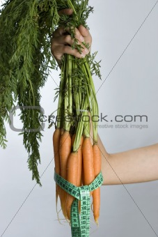 carrots with measuring tape