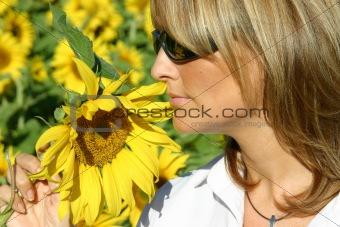 Beautiful sunflower woman in the sun