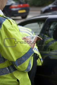 Traffic police officer writing details