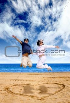 beach couple having fun - jumping