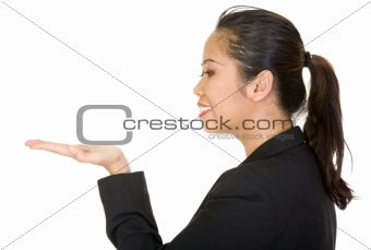 asian business woman holding something on her hand