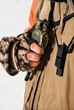 Hand holding walkie talkie.