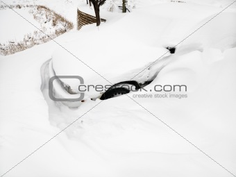 Car buried in snow.