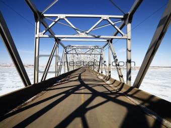 Shadows on bridge.