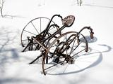 Metal plow in snow