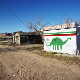 Painted dinosaur on building.