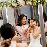Friend helping bride.