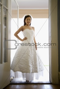 Bride standing in doorway.