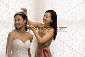 Bride and bridesmaid portrait.