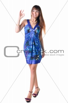 beautiful brunette in a dress showing ok gesture.