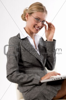 Beautiful business woman working on her laptop smiling